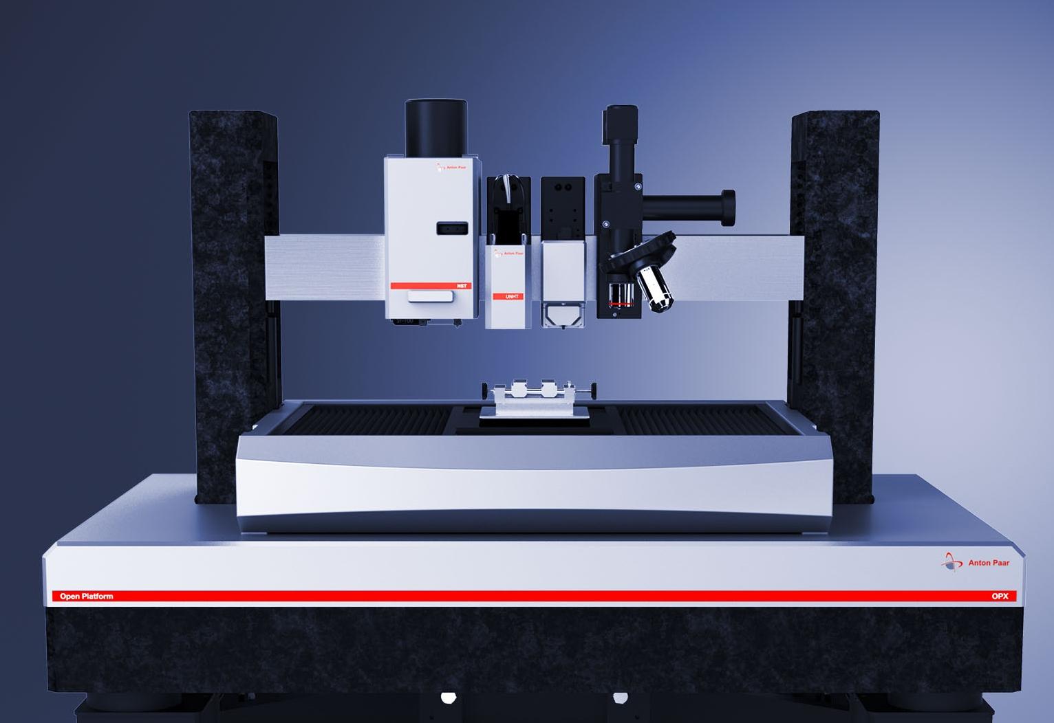 Ультра Нанотвердомер UNHT (второй слева) на Открытой платформе с модулями Микро-скретч тестирования MST, Атомно силовым микроскопом WideScan AFM и видеомикроскопом.